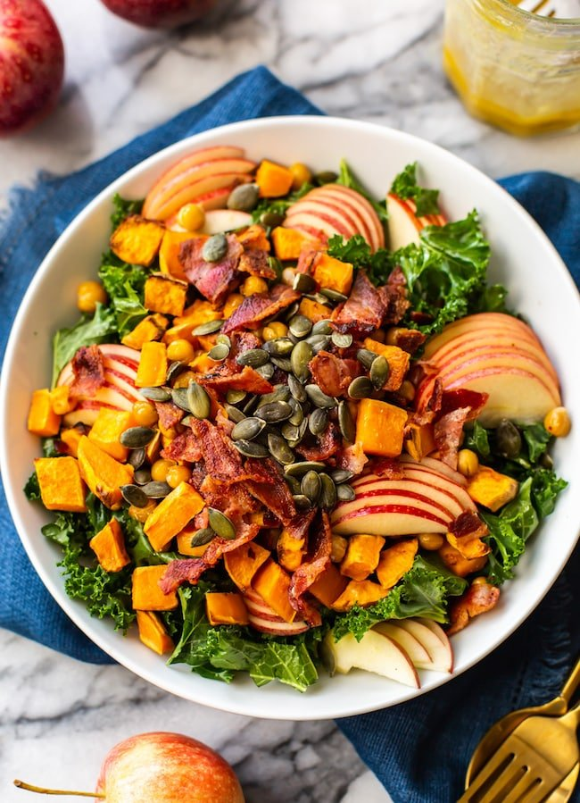 Roasted Sweet Potato & Chickpea Kale Apple Salad with Bacon in a bowl