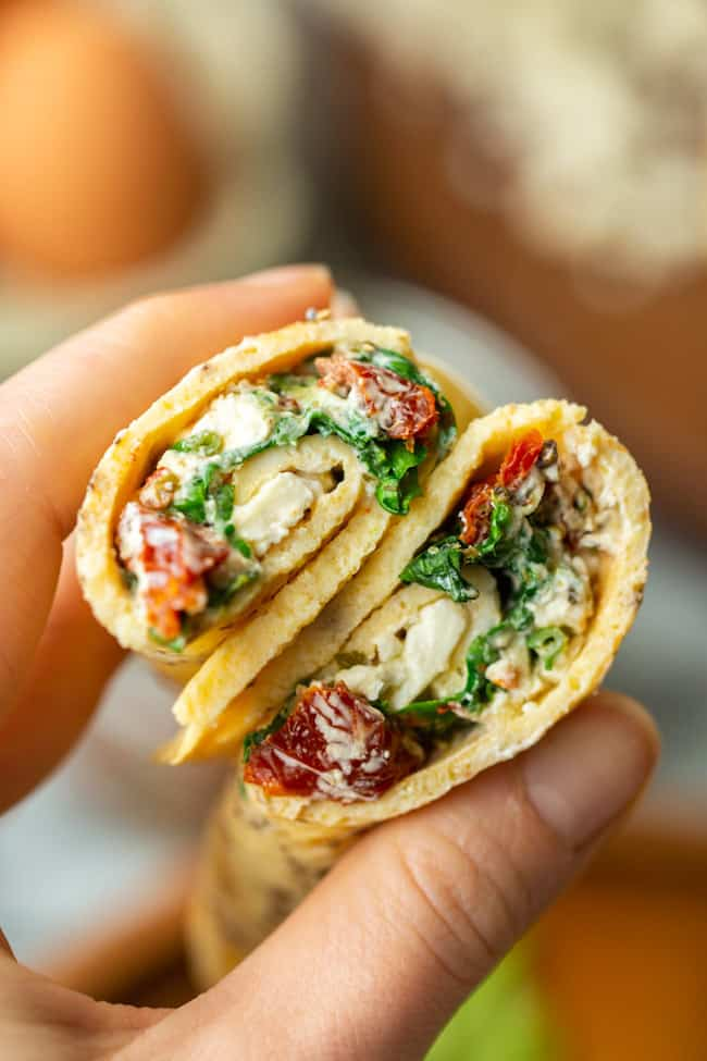 hands holding Low Carb Spinach Feta Egg Wraps