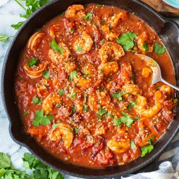 Mediterranean Shrimp Stew with a serving spoon
