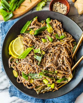 Spring Onion Peanut Noodles in a black bowl