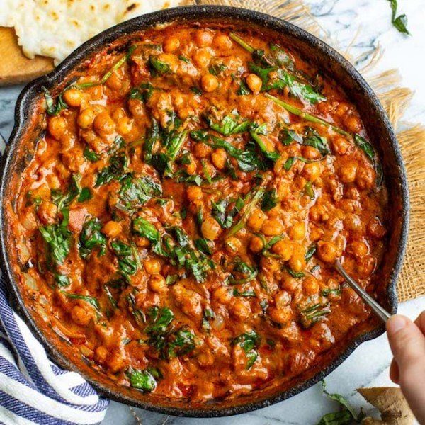 Tomato Basil Coconut Chickpea Curry in a cast iron skillet