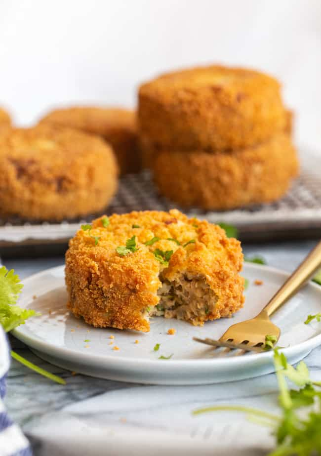Gluten Free Salmon Cakes on a plate with a bite taken out