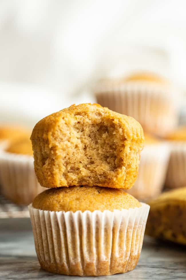 Gluten Free Banana Muffins stacked with a bite taken out