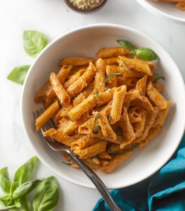 creamy cashew tomato pasta in a bowl