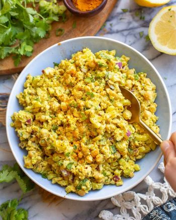 curried chickpea salad in a blue bowl