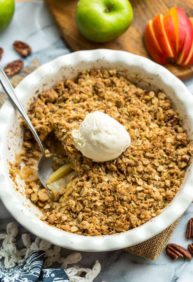 Gluten Free Apple Crisp in a baking dish with a spoonful scooped out.