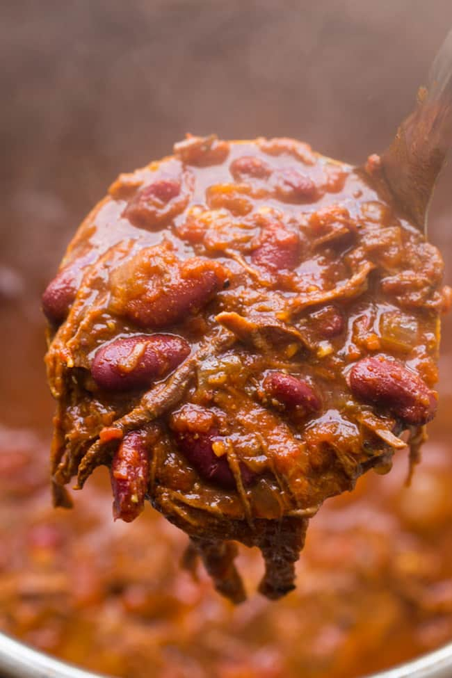 ladle full of Instant Pot Chili Con Carne with Shredded Beef
