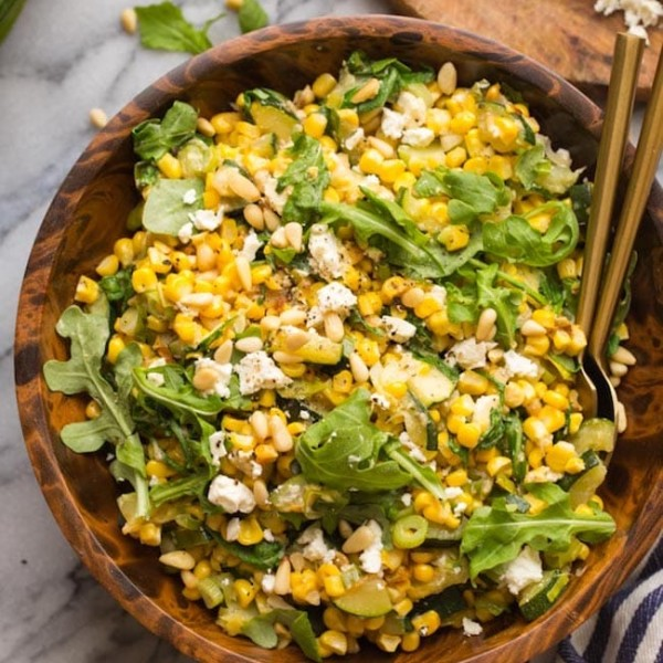 Sautéed Corn & Courgette Salad in a wooden salad bowl