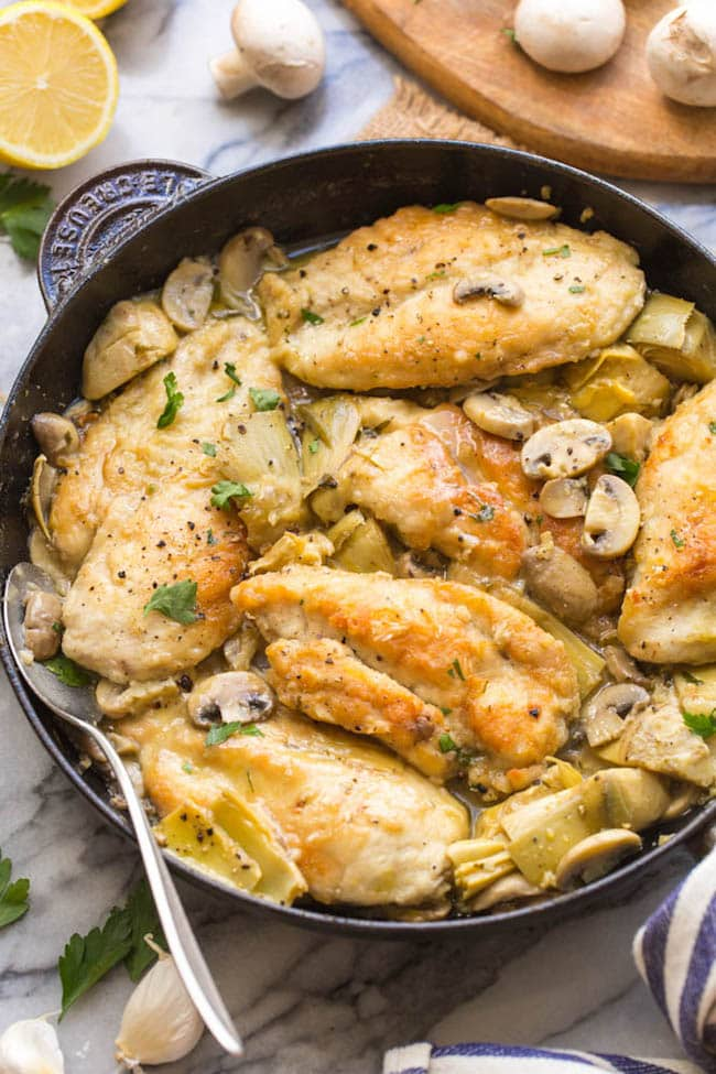skillet containing mushroom & artichoke chicken