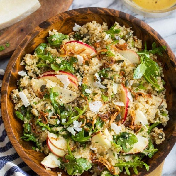 Honey Mustard Quinoa Apple Salad with Crispy Shallots mixed in a wooden bowl