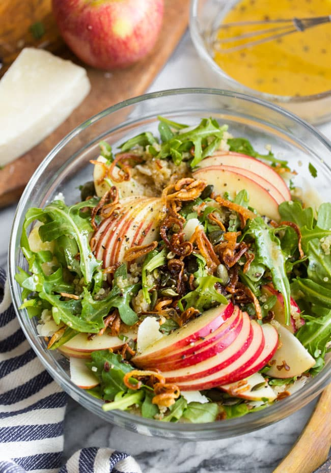 Honey Mustard Quinoa Apple Salad with Crispy Shallots in a salad bowl before mixed