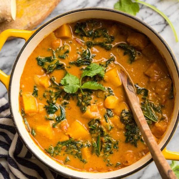 Peanut & Kale Butternut Squash Curry in a yellow pot