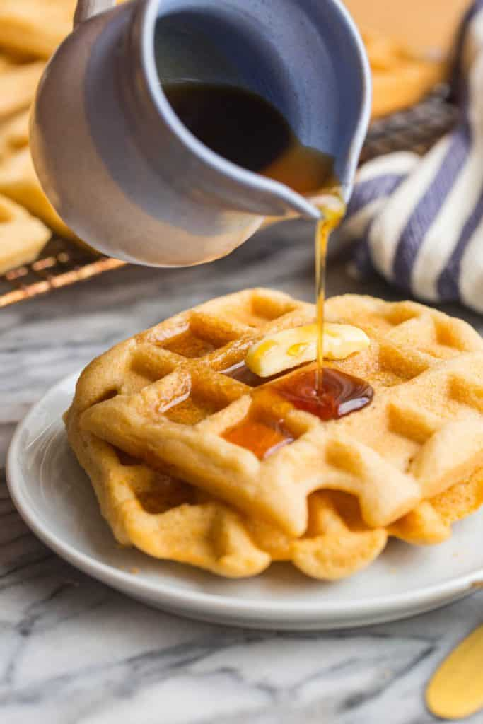 syrup pouring over Almond Flour Waffles