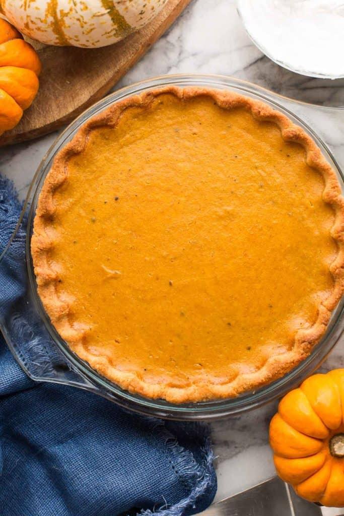 Paleo Pumpkin Pie in a glass pie plate