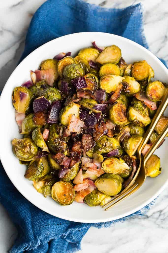 Roasted Maple Bacon Brussels Sprouts in a white serving bowl