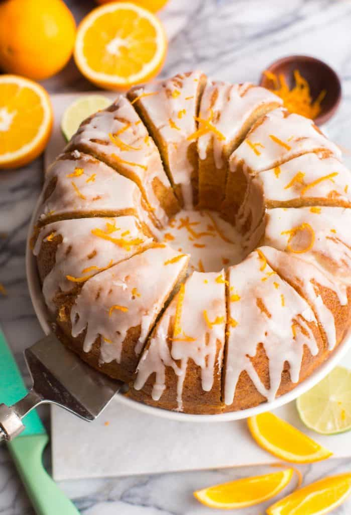 sliced Boozy Orange Drizzle Cake on a cake stand