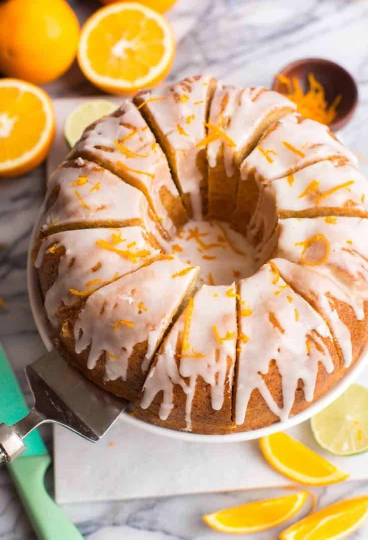 Zesty-Orange-Drizzle-Cake-on a cake stand