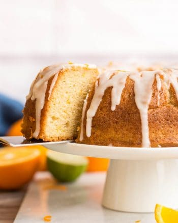 spatula picking up Zesty-Orange-Drizzle-Cake-