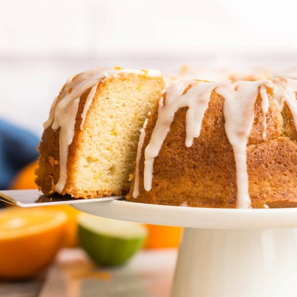 spatula picking up Zesty-Orange-Drizzle-Cake-