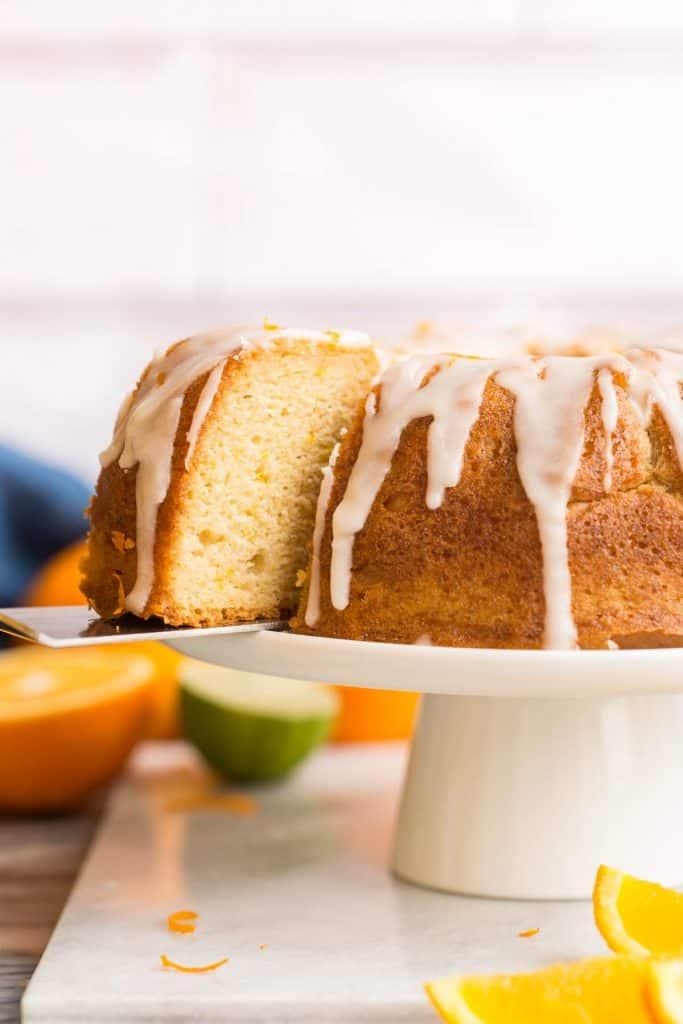 spatula lifting a slice of Orange Drizzle Cake