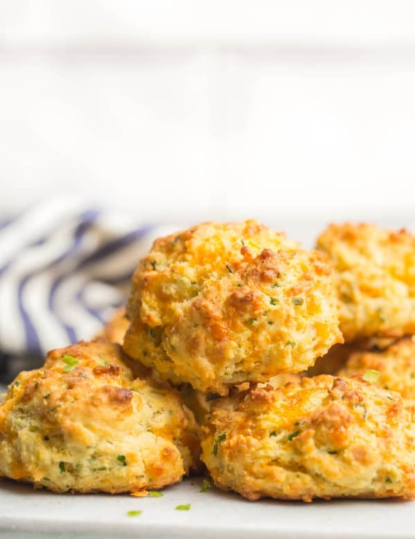 cheesy gluten free biscuit piled on a platter