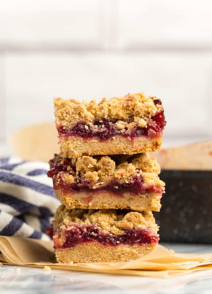 three Gluten Free Cranberry Crumble Bars stacked