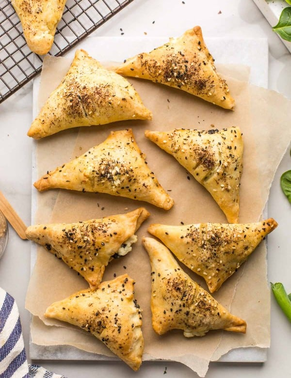 Gluten Free Spinach & Feta Parcels on a sheet of baking paper