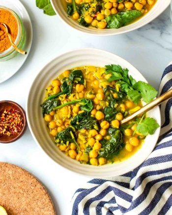 Persian Inspired Zesty Chickpea Soup topped with fresh herbs