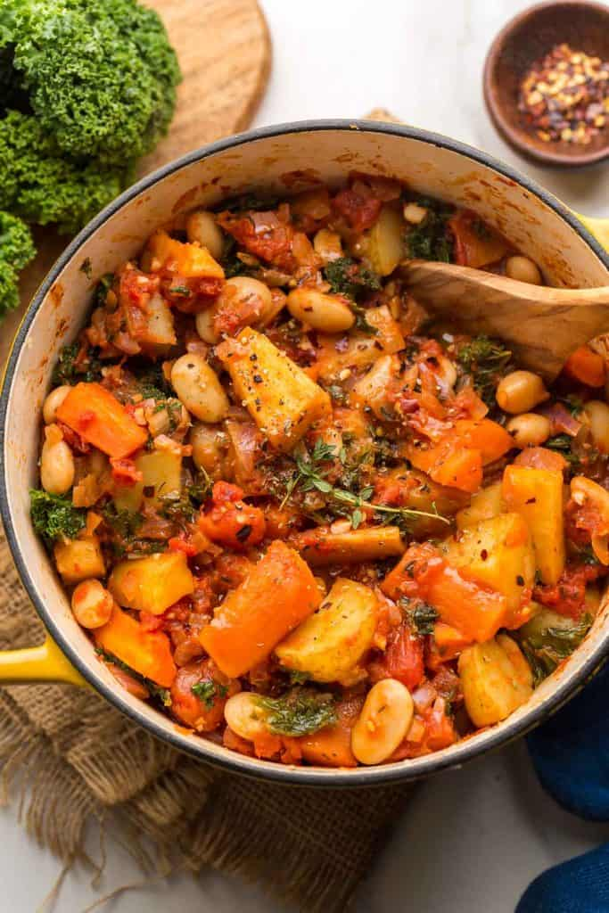 Roasted Root Vegetable Stew in a yellow cooking pot