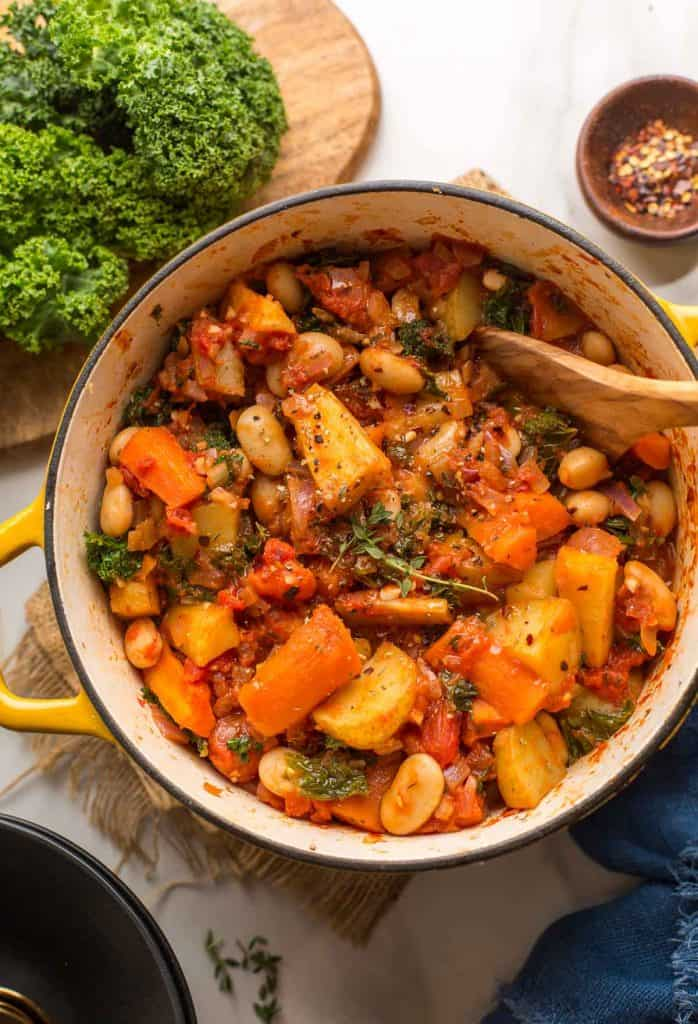 Roasted Root Vegetable Stew in a big yellow cooking pot