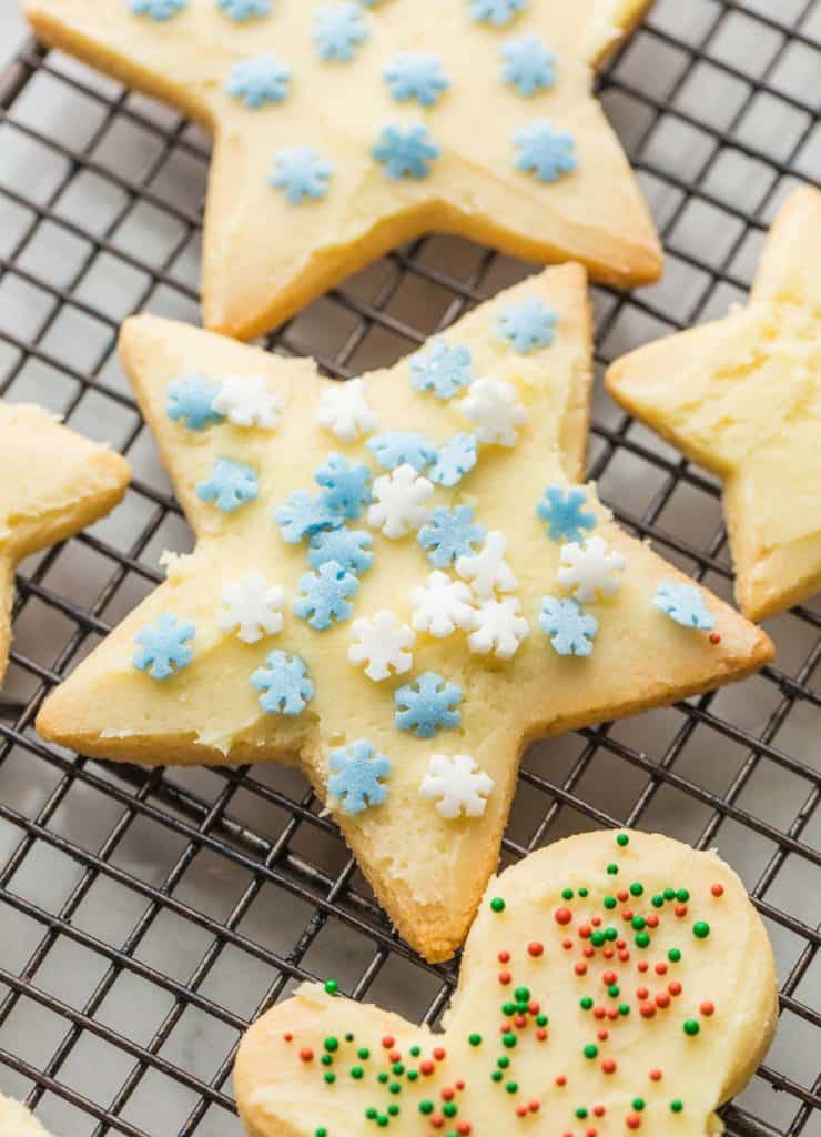 Almond Flour Sugar Cookies frosted with snowflake sprinkles