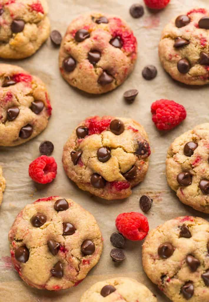 Almond Flour Raspberry Chocolate Chip Cookies surrounded by raspberries and chocolate chips