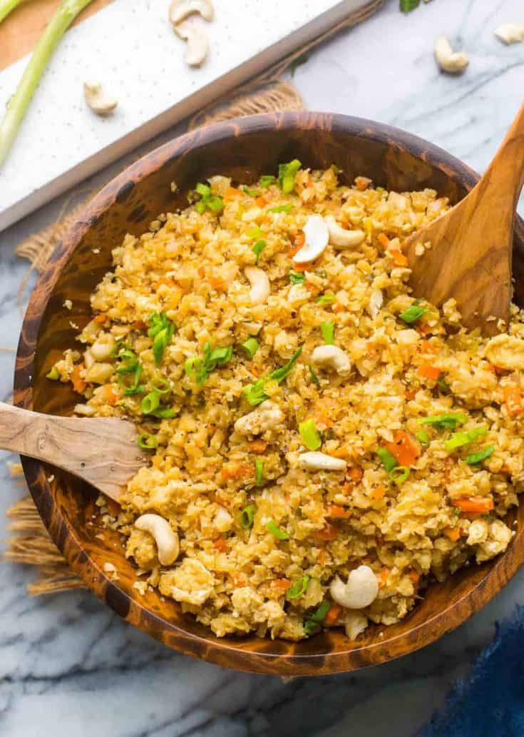 Cauliflower Egg Fried Rice in a wooden serving bowl