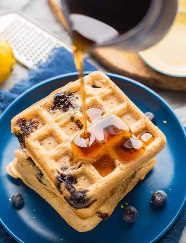 Gluten Free Blueberry Waffles with syrup pouring over top
