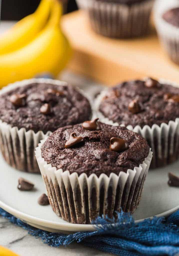 three Paleo Chocolate Banana Muffins on a small blue plate