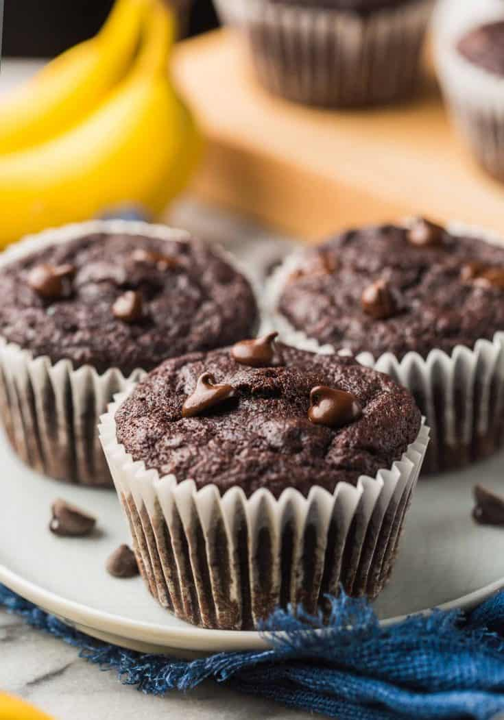 three Paleo Chocolate Banana Muffins on a small plate