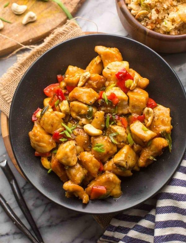 paleo cashew chicken in a black serving bowl