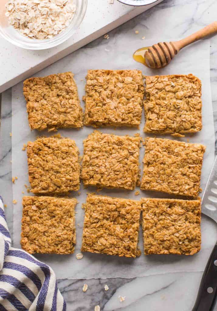 Gluten Free Flapjacks cut into slices on a marble surface