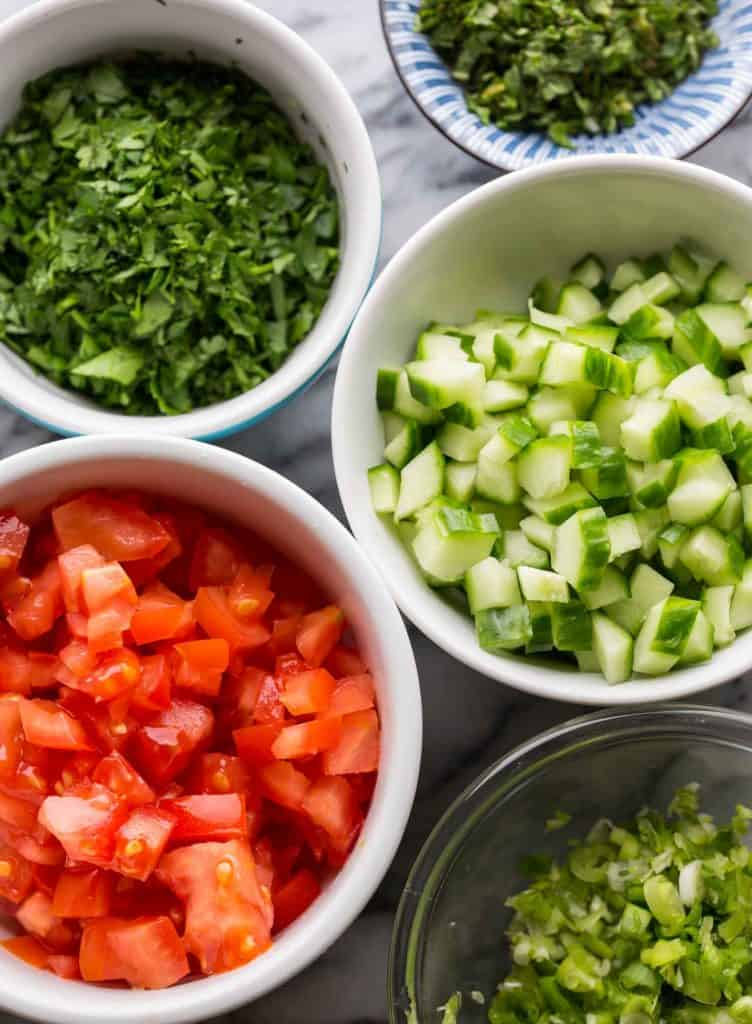 salad ingredients diced and chopped in little bowls
