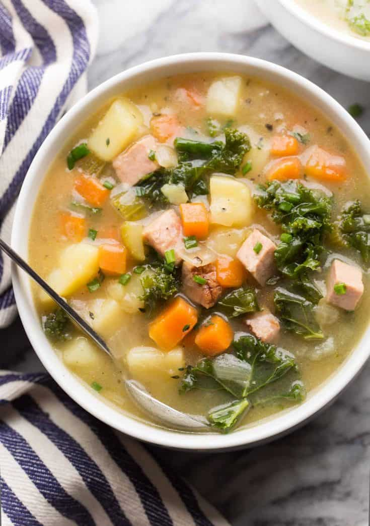 dairy free ham and potato soup in a white soup bowl