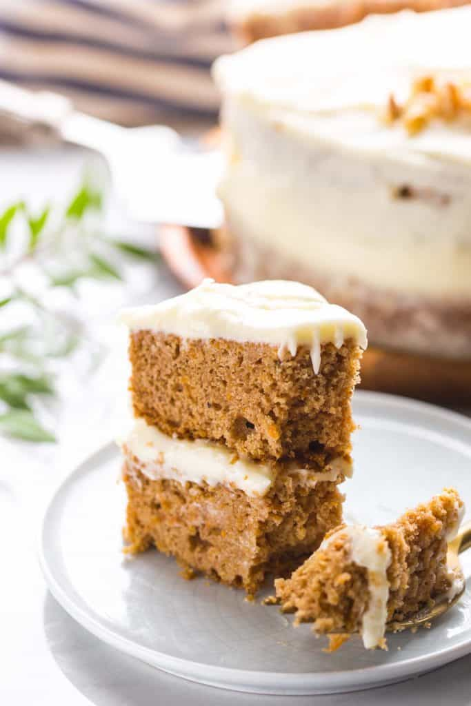a slice of Gluten Free Carrot Cake on a small plate