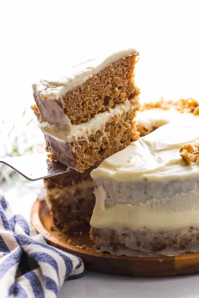 cake knife holding up a slice of Gluten Free Carrot Cake