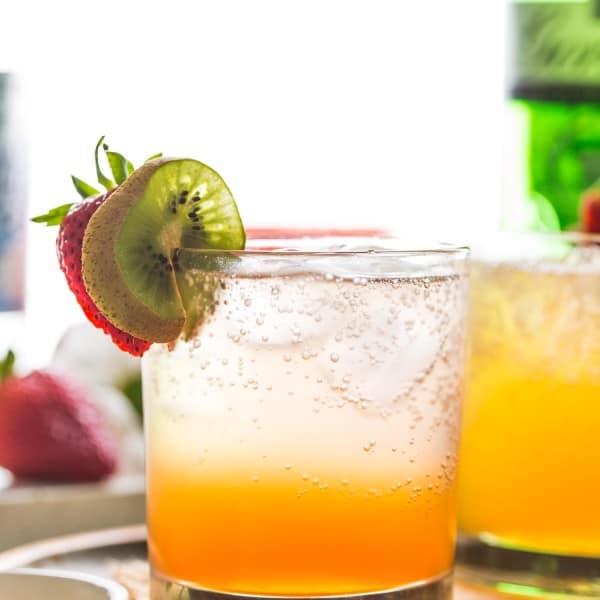 Strawberry Kiwi Gin & Tonic garnished with fruit