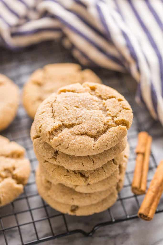 Almond Flour Snickerdoodles stacked on a wire cooling rack