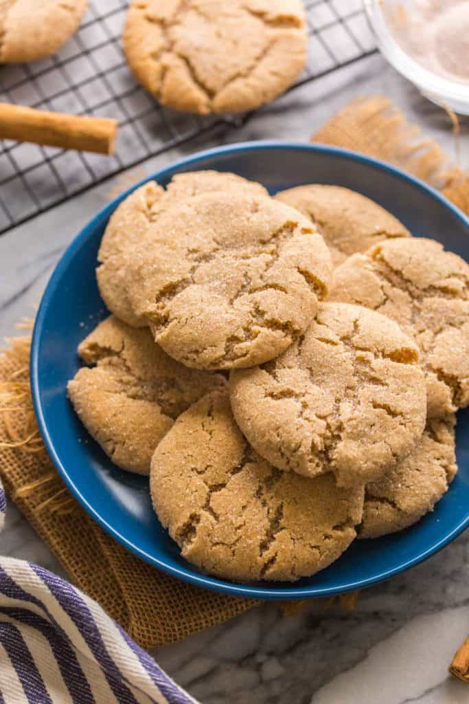 Almond Flour Snickerdoodles piled on a blue plate