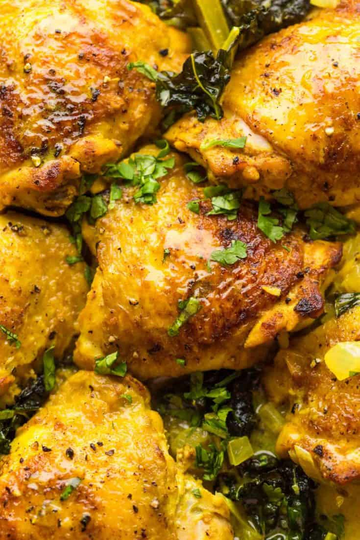 Coconut-Turmeric-Chicken-Thighs up close and sprinkled with cilantro