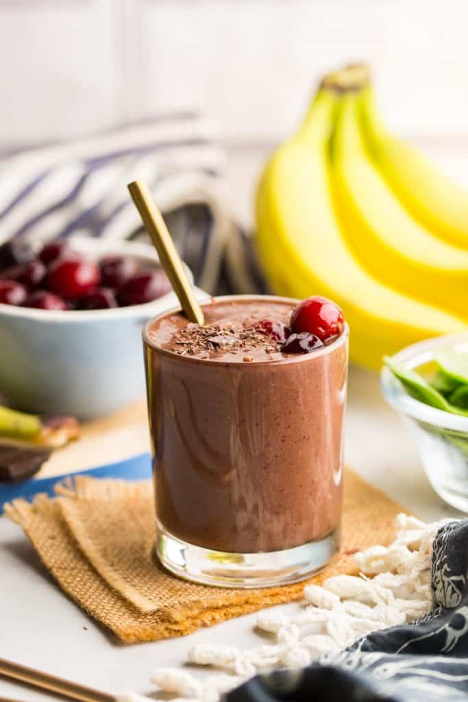 Black Forest Smoothie surrounded by fresh fruit