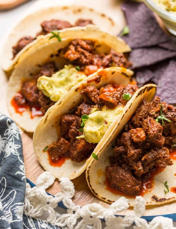 Instant-Pot-Adobada-Tacos_ on a wooden plate