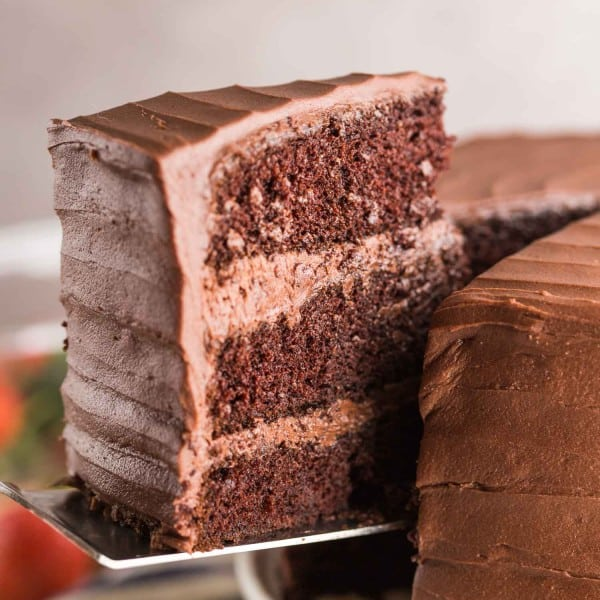 slice of gluten free chocolate cake picked up by a spatula