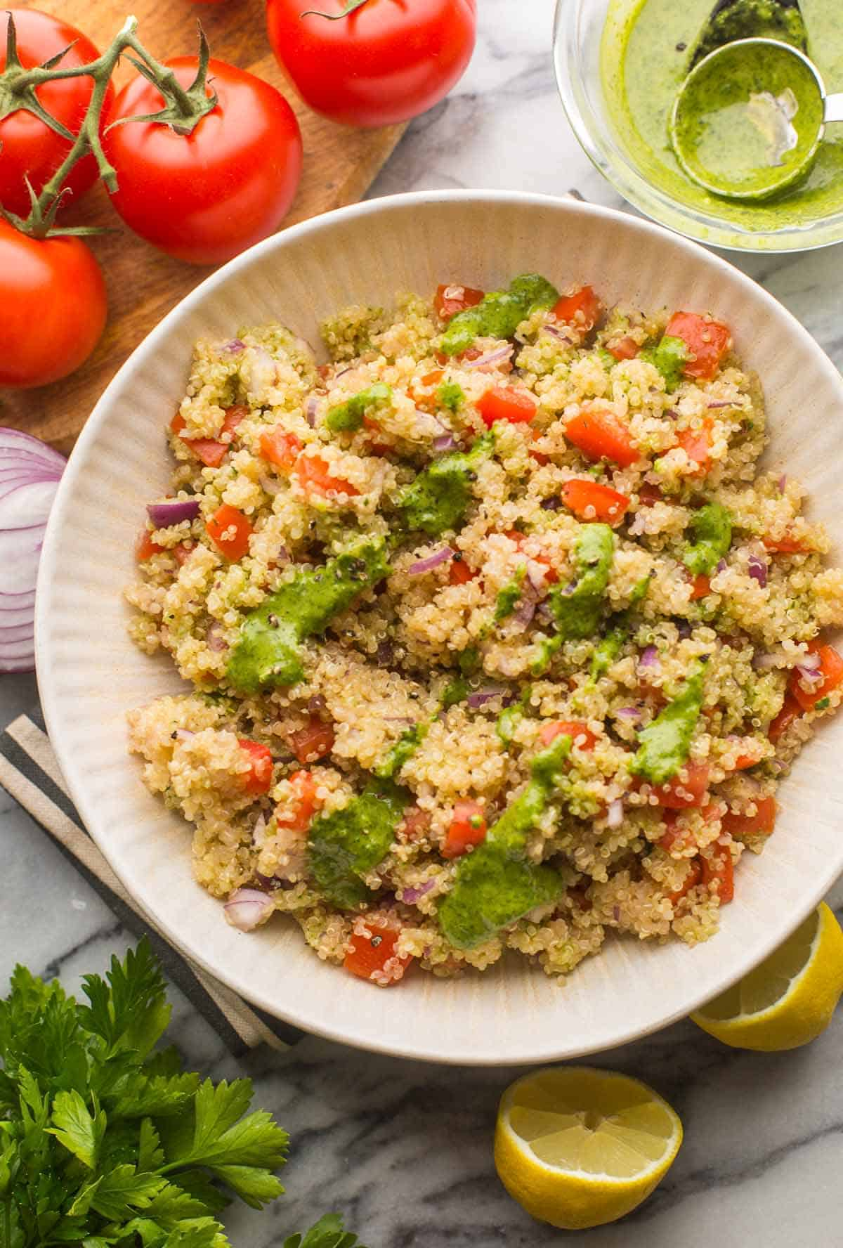 Tomato Quinoa Salad with a Zhoug Style Dressing